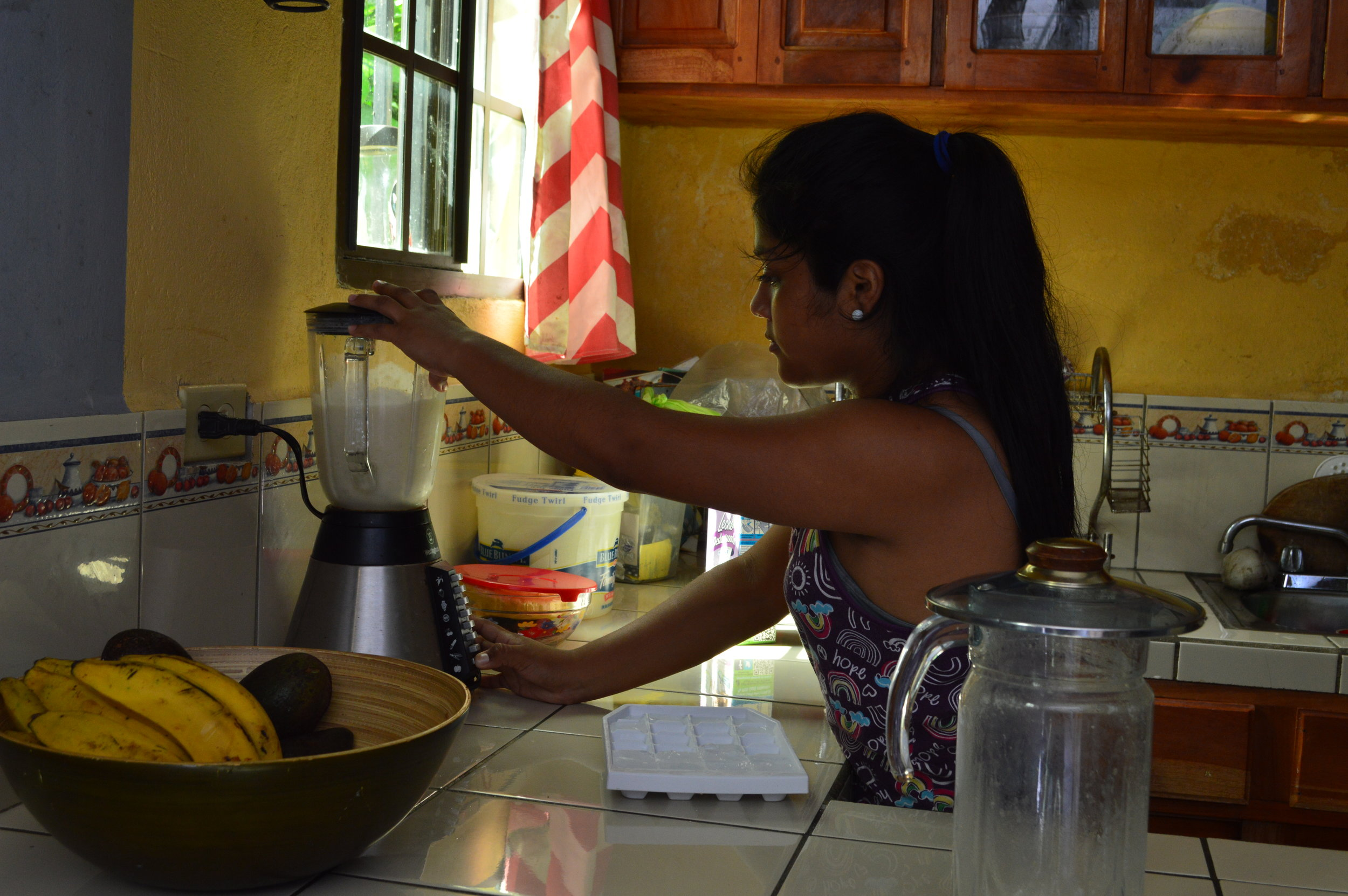 My host making a banana milkshake