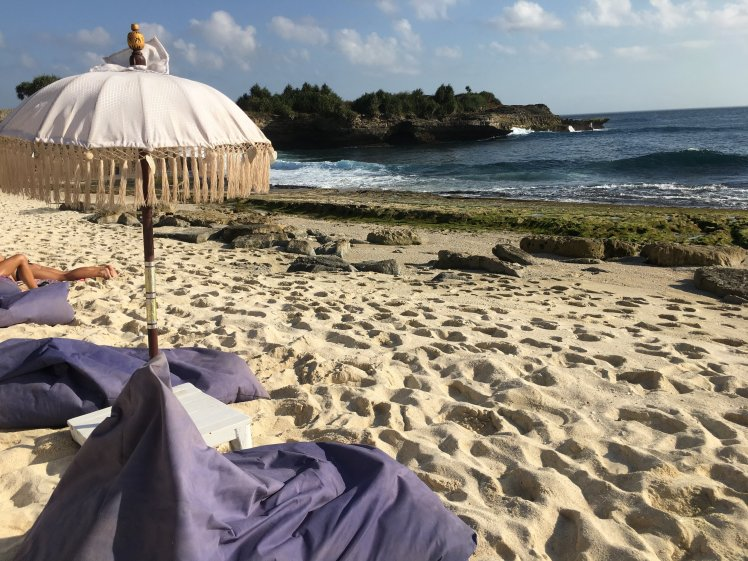 Bean bag chairs and sunbrellas on Sandy Bay beach