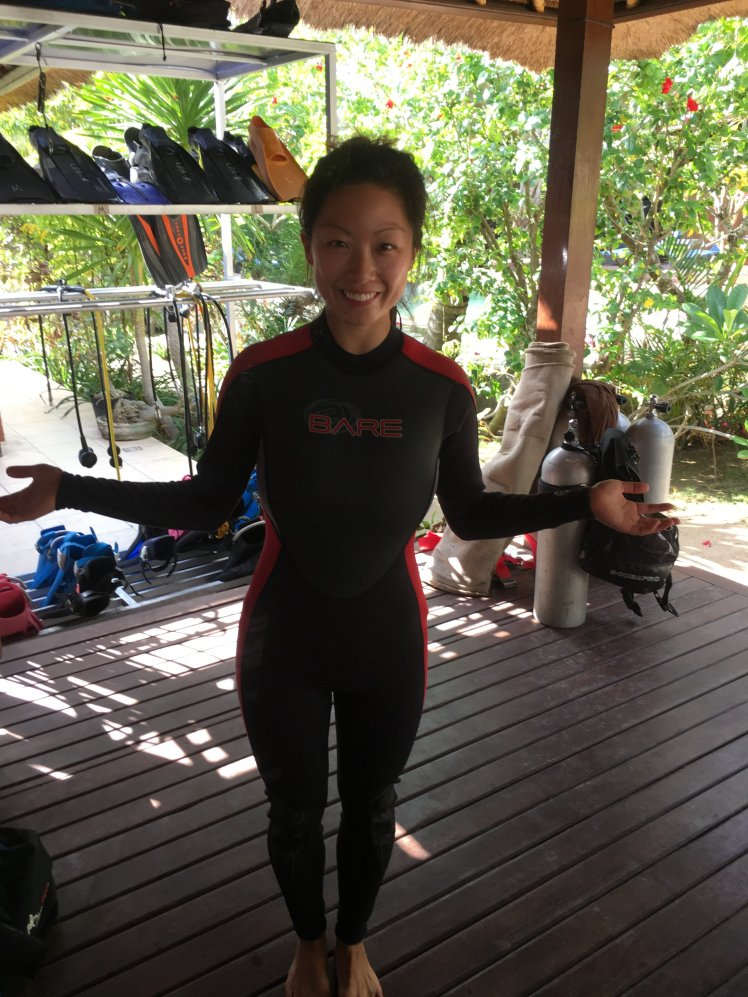 I wore a kid's size 3mm wetsuit underneath a women's XS 3mm wetsuit