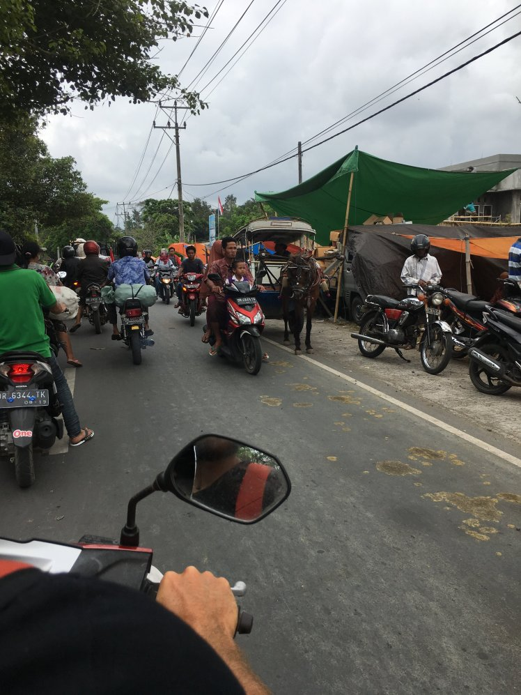 On motorbike in the busy streets of Mataram, Lombok
