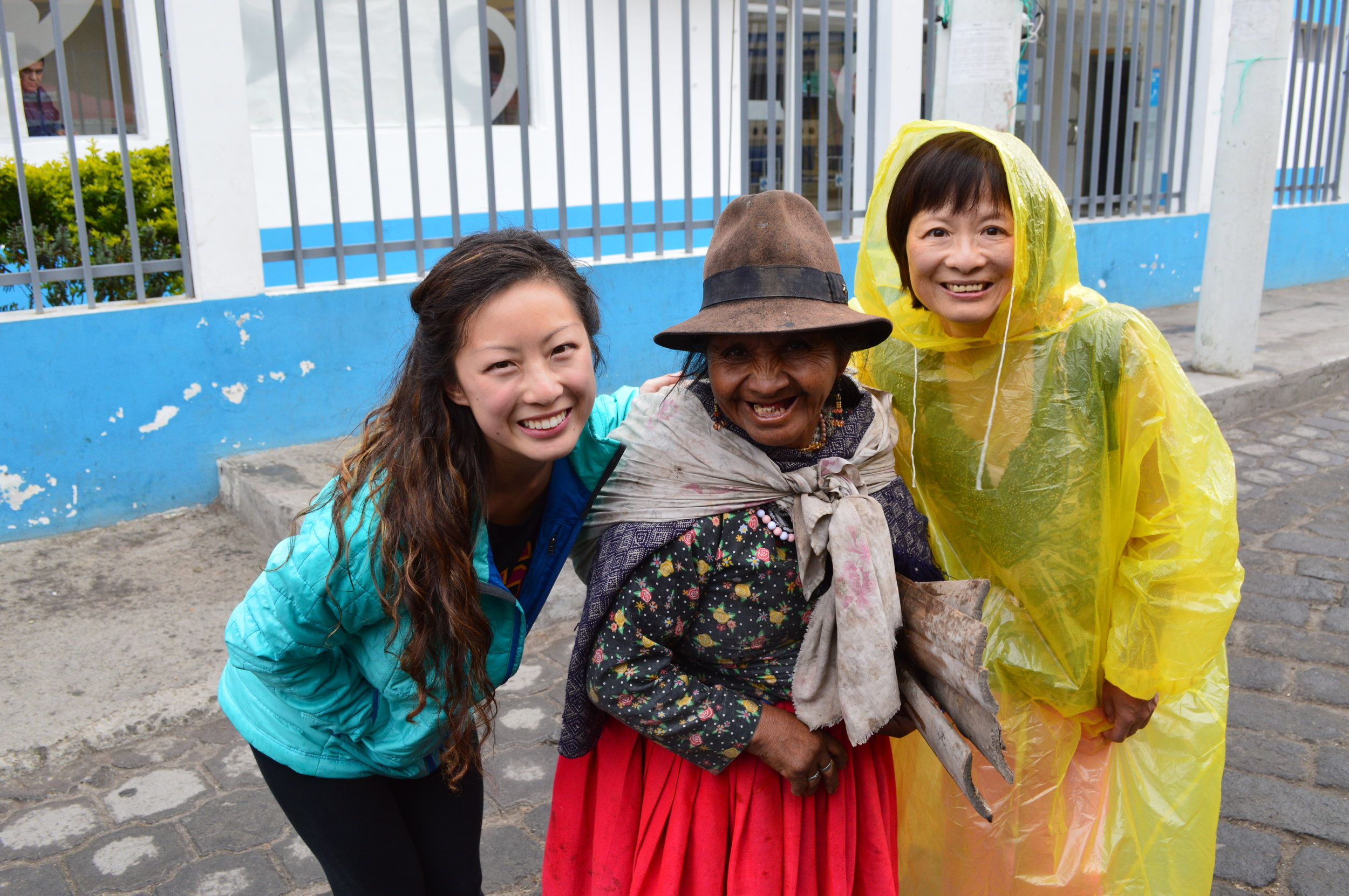 It began drizzling and my mom threw on her bright yellow poncho which quickly became a laughing matter for everyone we walked by. This lady was so amused that she wanted a picture with us...how sweet!