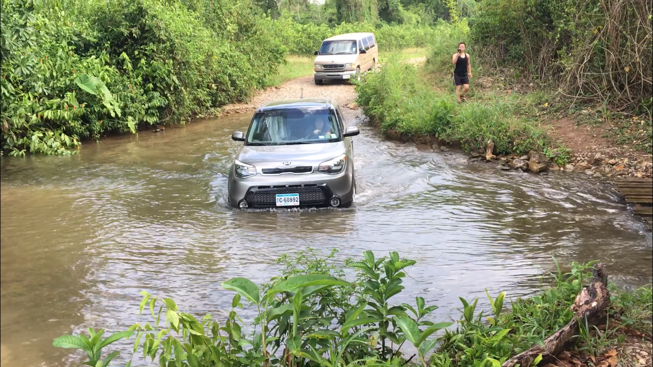 I don't recommend driving to the entrance yourself during rainy season. Let the tour guides pick you up! (Yes, that's me driving across the creek in hopes that I don't stall out)