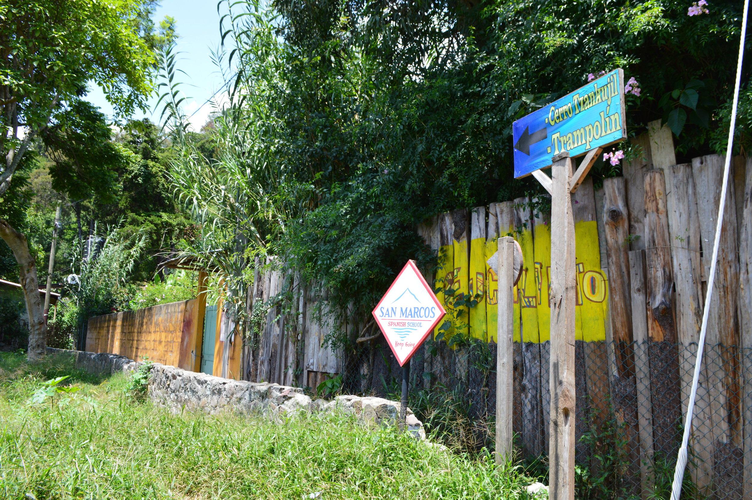 Small path along the stone wall to the entrance of Cerro Tzankujil