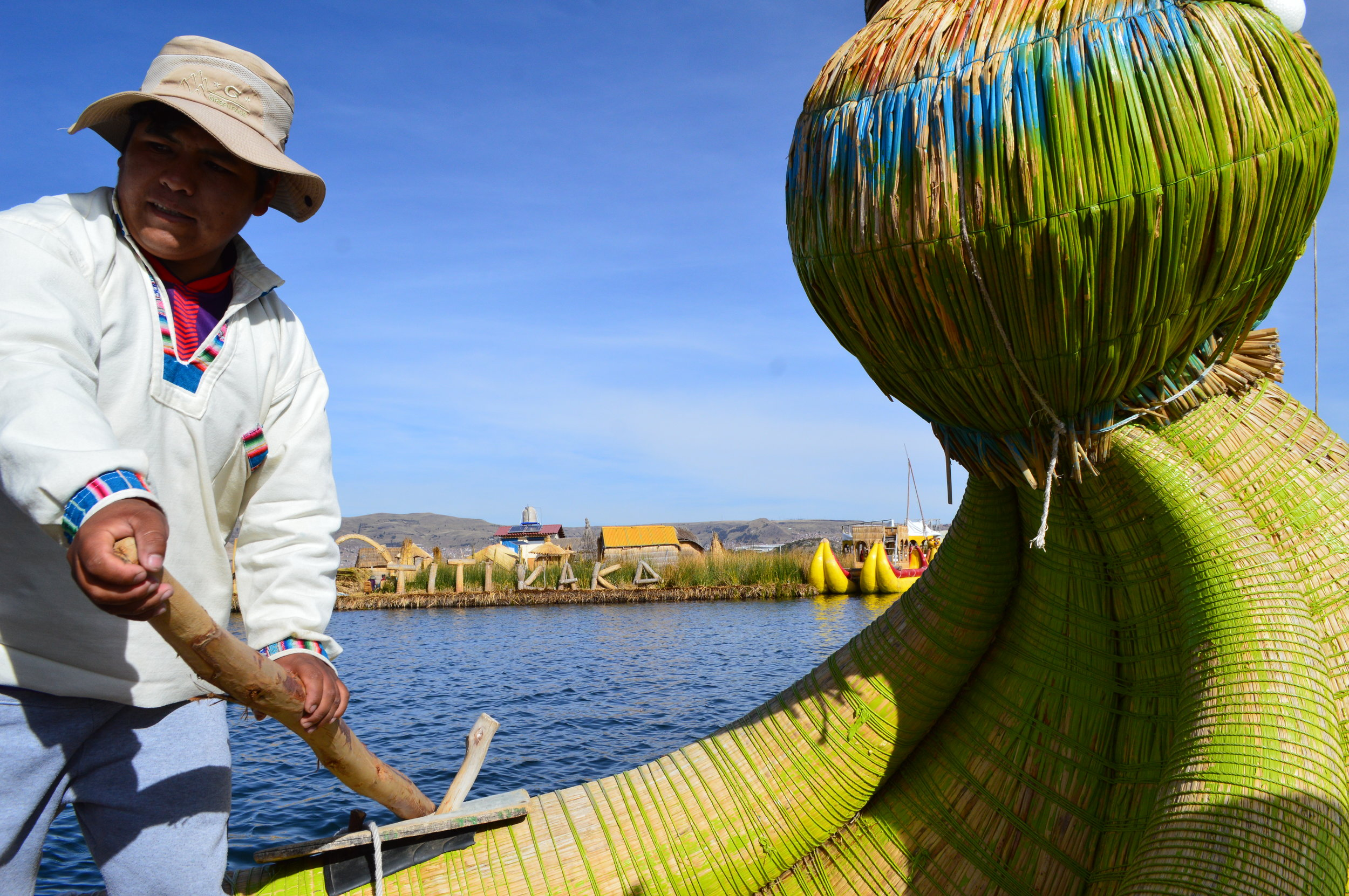 The president of one of the floating islands rowing this traditional boat