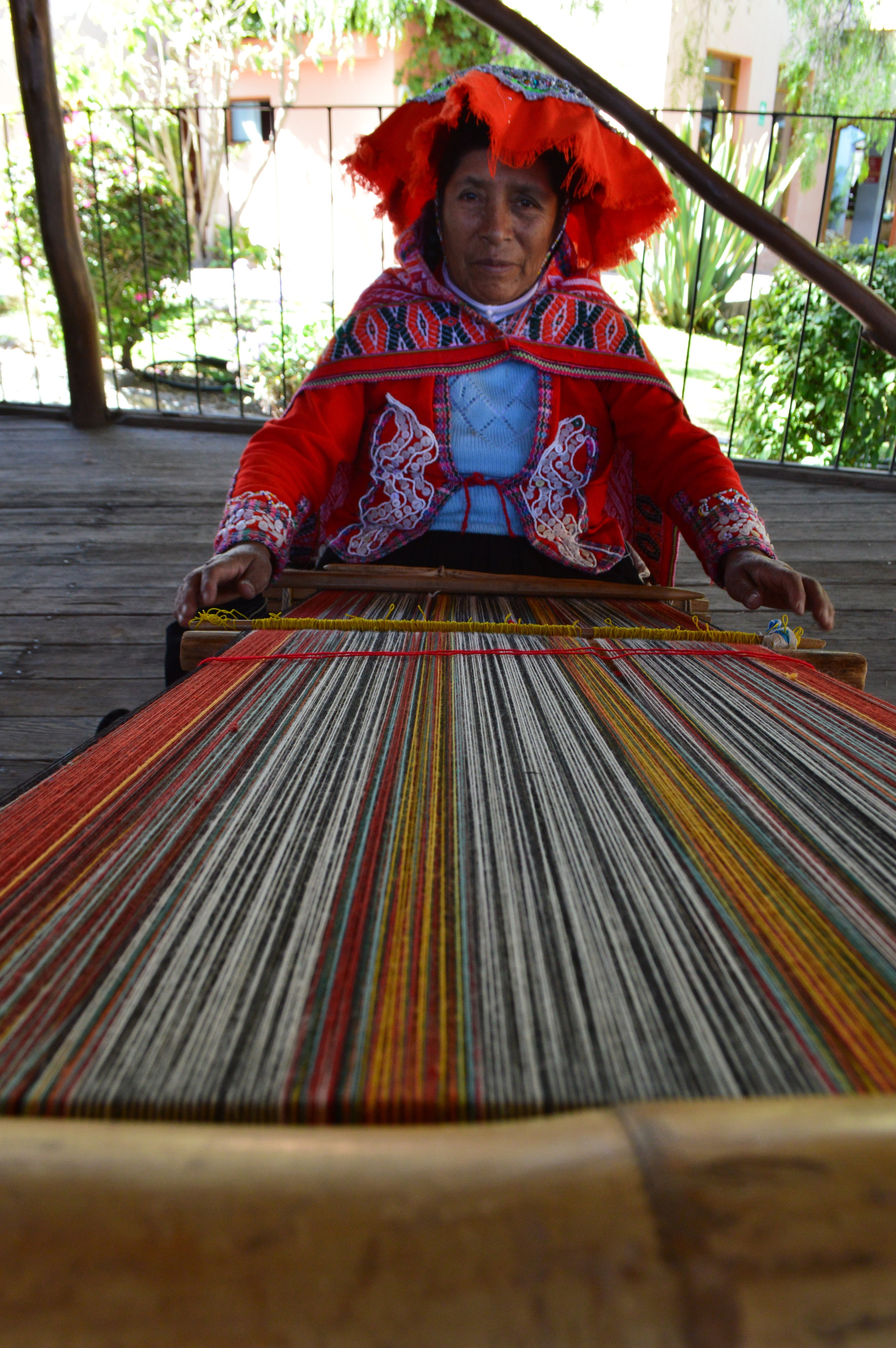 Local woman weaving a scarf
